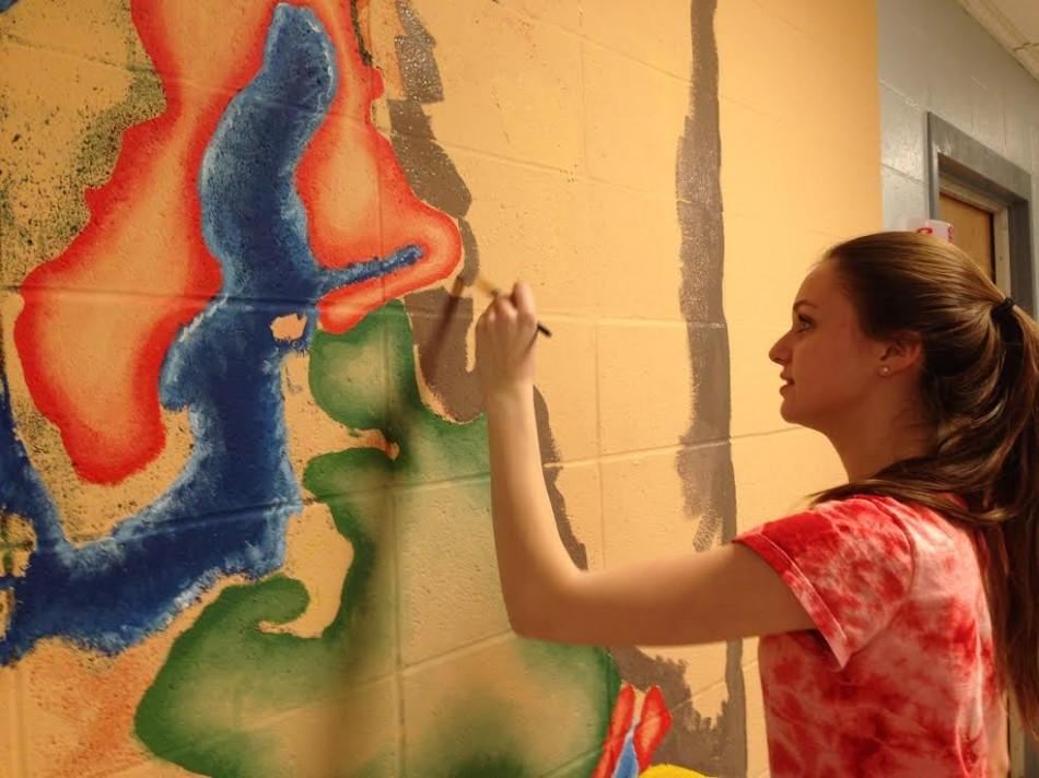 Senior Hannah Carlon works on the Shakespearean map outside Mr. O'Toole's room.
