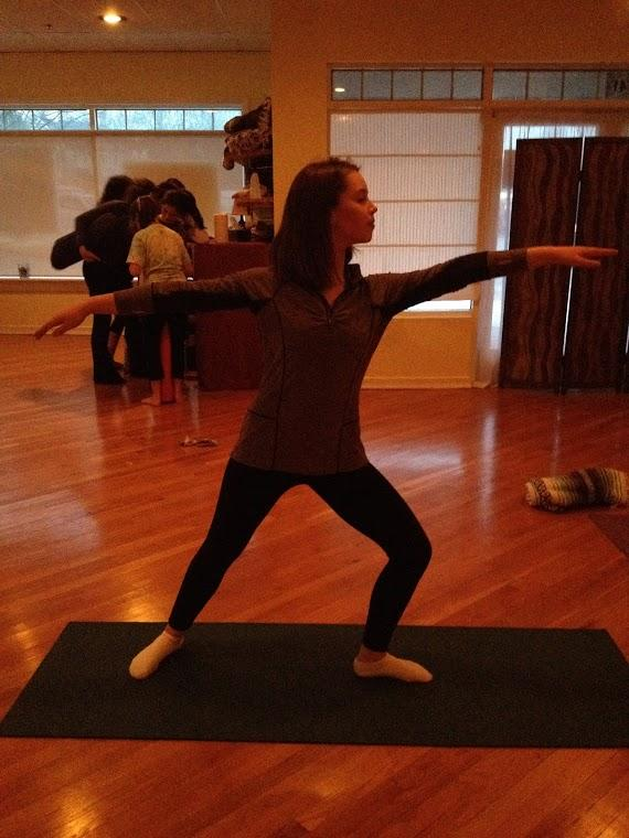 Insight staff writer, Mary Anglin, practices warrior two pose at the Centerville Wellness Center.
