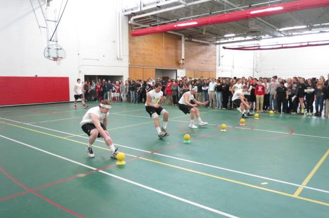 The Balled Eagles rush the line of dodgeballs.