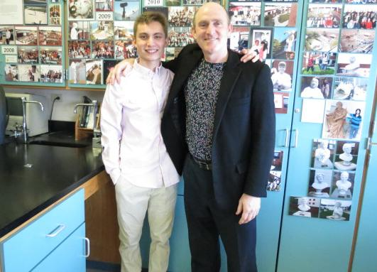 The Kennedy Center/Stephen Sondheim Inspirational Teacher Award-winner Michael Gyra and BHS graduate Russell Brillant pose in Gyra's classroom. Brillant, a former astronomy student, nominated Gyra for the award last fall.