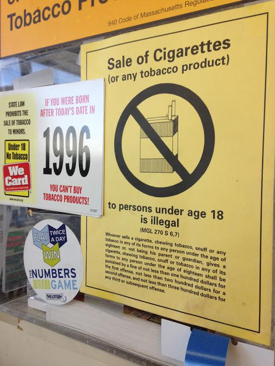 Signs outside of convenience stores make it clear they will not sell tobacco to people underage.