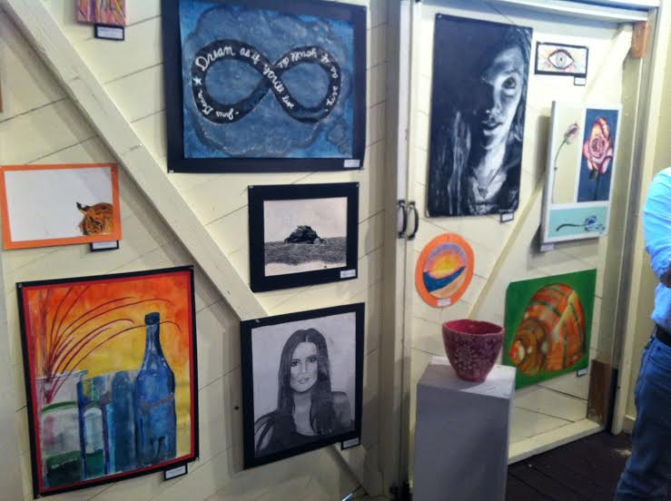 Various pieces of student's art work are displayed.
