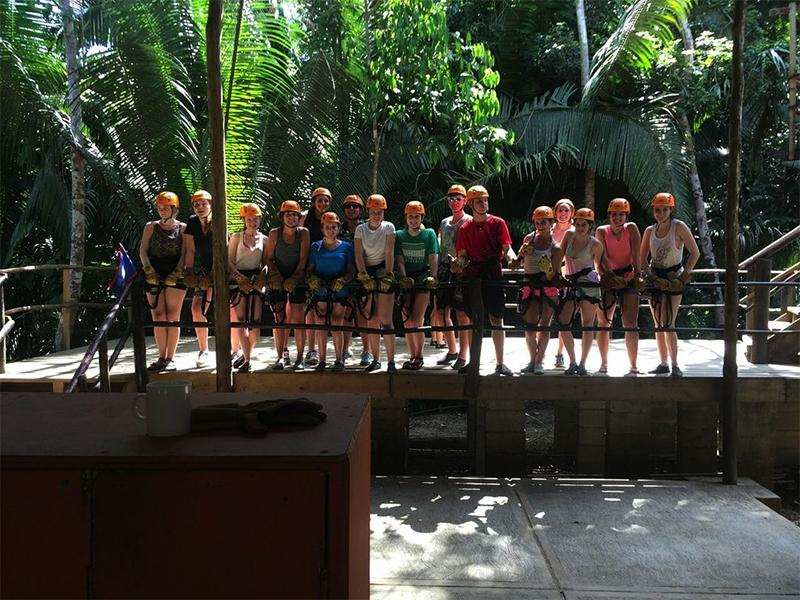 Students on the Belize trip donned harnesses in the jungle as they prepared for a zip lining excursion.
