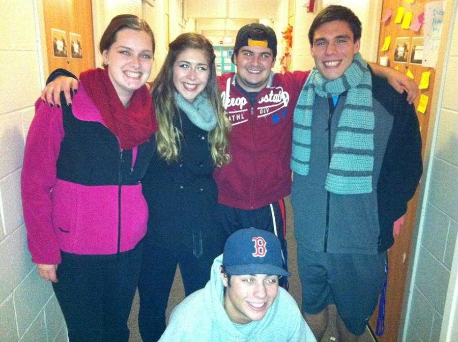 Richie Carter, far right, stands in his dorm hallway with some of his new college friends.