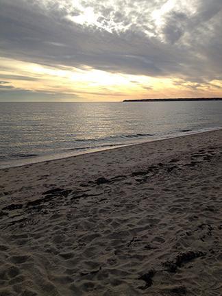 The ocean sparkles at Craigville beach in December.