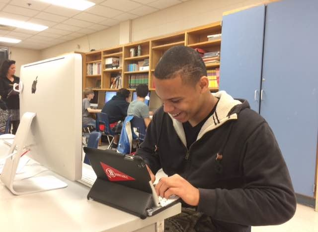 CJ Turner enjoying his graphic design class.
