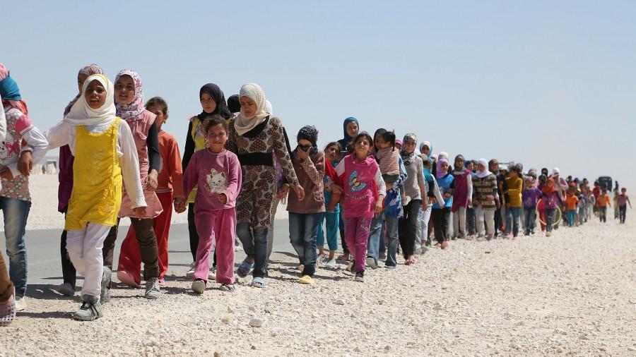 Syrian children march in the refugee camp in Jordan.