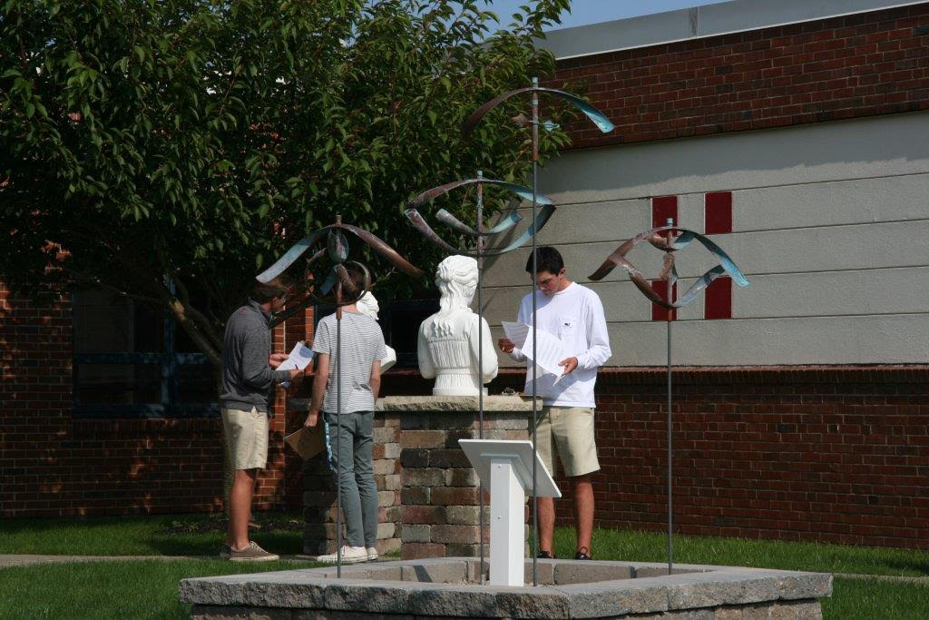 Students observe the sculpture in the Astro Park