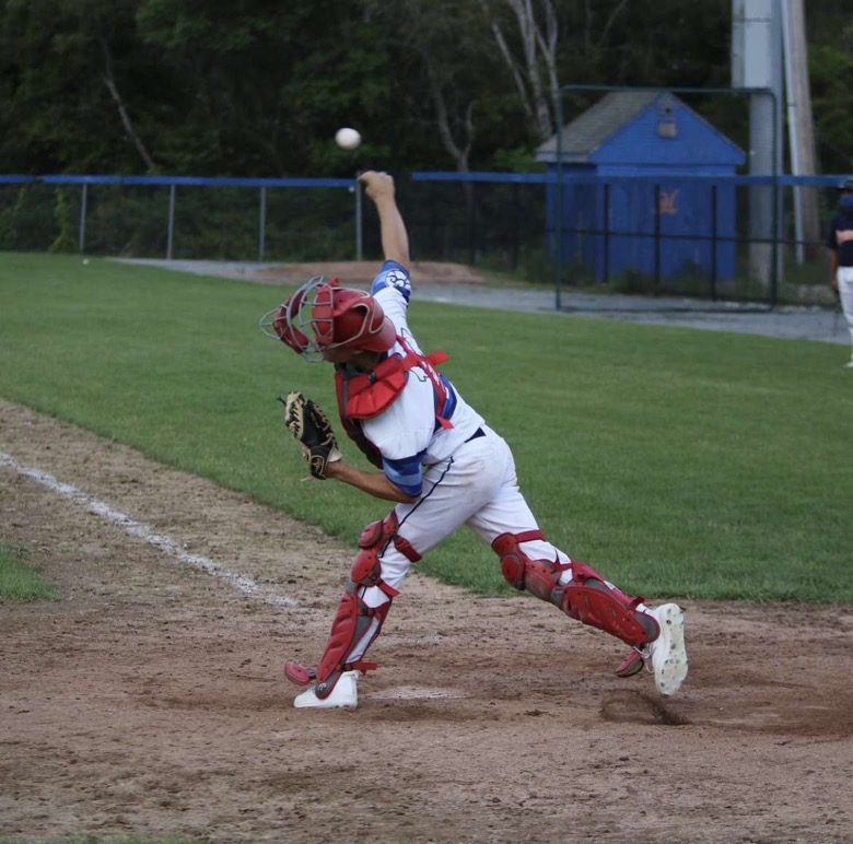 Meagher throwing a runner out